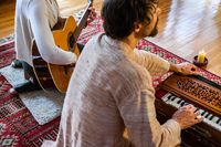 Man and woman playing musical instrument
