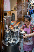 Woman selling delicious traditional chinese dumplings
