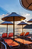 Sun beds and beach umbrellas