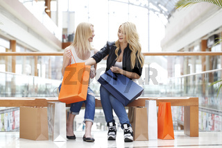 Girls looking into shopping bag