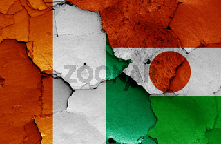 flags of Ivory Coast and Niger painted on cracked wall
