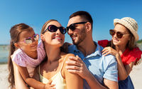 happy family in sunglasses on summer beach