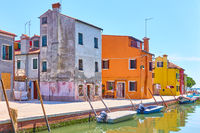 Canal with boats and colorful houses in Burano