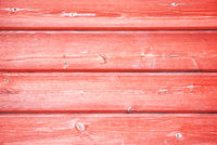Old wooden background with the red peeled-off paint