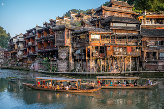 Sightseeing boats with tourists in Fenghuang