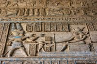 Hieroglyphic carvings in egyptian temple