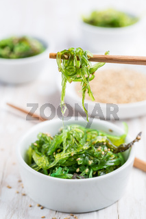 Traditional Japanese wakame salad with sesam seeds. Healthy and fresh seaweed salad.