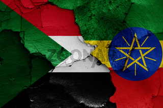flags of Sudan and Ethiopia painted on cracked wall