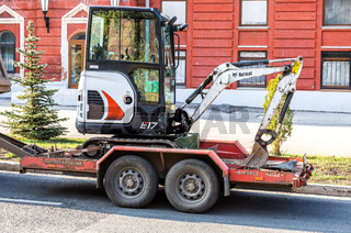Transportation of small backhoe on a cargo platform