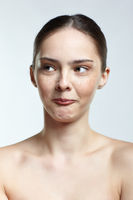 Headshot of emotional female face portrait with mocking facial expression.