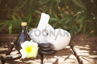 Spa supplies on wooden floor in garden