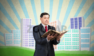 Senior businessman holding open book