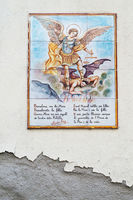 BARCELONA, SPAIN - JUNE 2, 2013: Picture of a mosaic depicting the angel and devil. An image of specially painted tiles and pieces of glaze on the wall of a house in Barcelona