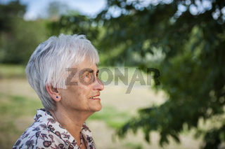 Head portrait of a white haired pensioner profile
