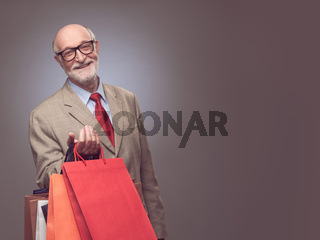 Senior man with shopping bags