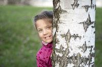 behind birch stem