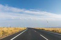 curve road motion blur through the wind farm