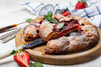 Summer pie with strawberries and basil.