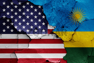 flags of USA and Rwanda painted on cracked wall