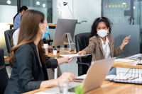 Social distance office with business team wear face mask as new normal life