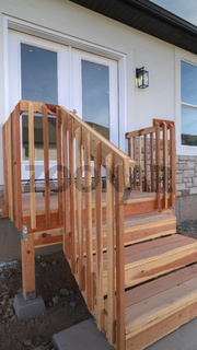 Vertical frame Wooden steps leading to an elevated front door