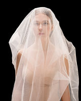Young woman in bra and white veil cropped shot