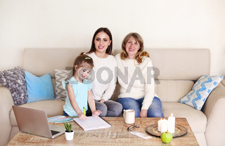 Loving mature woman with young daughter and granddaughter
