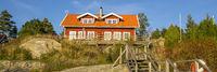 Red cottages island Harstena in Sweden