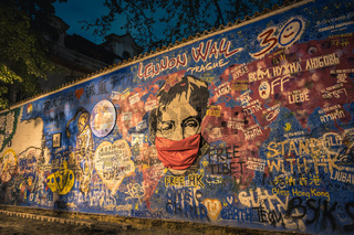 PRAGUE, CZECH REPUBLIC, APRIL 2020 - The John Lennon Wall. Famous place in Prague - Wall is filled with John Lennon inspired graffiti and lyrics from Beatles songs