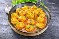 Meatballs in pan on board