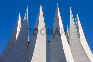 white futuristic roof with spikes, isolated on blue sky