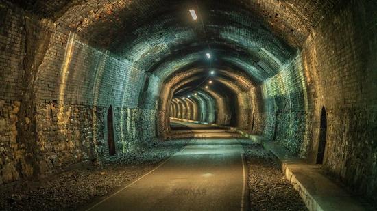 Walking through the Headstone Tunnel, Derbyshire, England, UK