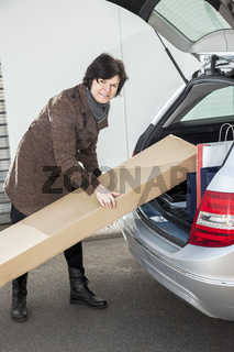 Woman invites her package in the car