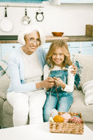 Granddaughter visits her grandmother for knitting