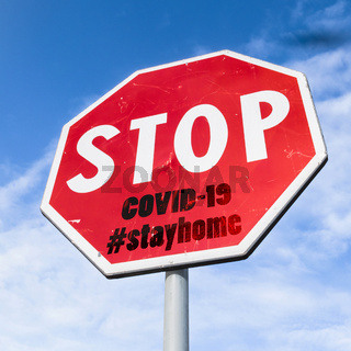 Grungy stop sign with hashtag #stayhome