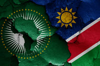 flags of African Union and Namibia painted on cracked wall