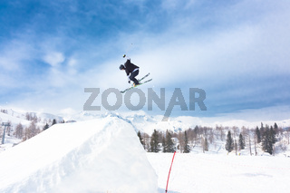 Free style skier performing a high jump