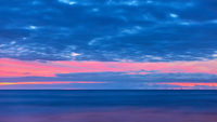 Atlantic ocean and sky with clouds after sunset