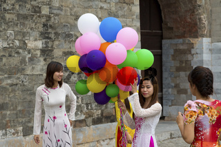 Vietnamese Girl with Balloons on the Ground of the Citafel of Thang in Hanoi