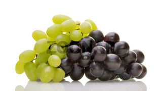Ripe white and red wine grapes with stalk isolated on white background. Healthy food, grocery, vegan lifestyle and organic fair trade concept.