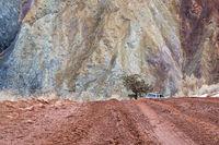 muddy canyon dirt road with SUV car