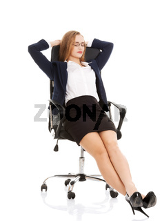 Relaxed business woman sitting on a chair with closed eyes.
