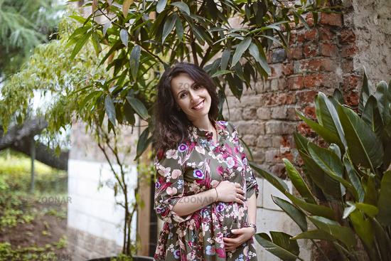 Beautiful pregnant woman in the garden