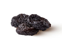 Heap of natural organic sweet prune isolated on a white background.