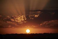 Sunset sun setting behind the horizon