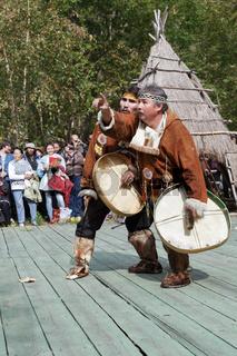 Dance folk ensemble ethnic dance with tambourines in clothing aborigine of Kamchatka Peninsula