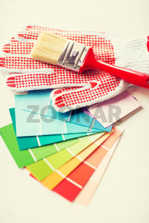 paintbrush, gloves and pantone samplers