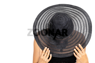 Young woman hides her face with sun hat isolated on white background