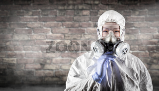 Chinese Woman Wearing Hazmat Suit, Protective Gas Mask and Goggles Against Brick Wall
