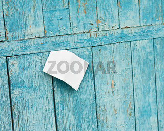 Sheet of Paper on Old Blue Wooden Background.